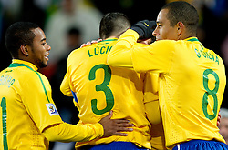 Brazil players Robinho, Licio, Gilberto Silva celebrate  during the 2010 FIFA World Cup South Africa Group G match between Brazil and North Korea at Ellis Park Stadium on June 15, 2010 in Johannesburg, South Africa.  (Photo by Vid Ponikvar / Sportida)
