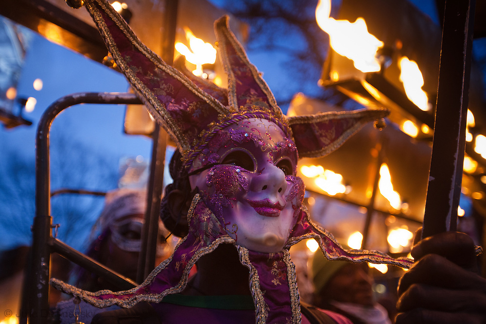 New Orleans, Louisiana, February 19, Flambeaux carriers, part of a tradition that goes back to slaves and free African Americans who carried flames to light the way of Mardi Gras parade, get ready to carry flames in the Bacchus parade.