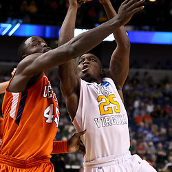 Mar 17, 2011; Tampa, FL, USA; West Virginia Mountaineers guard Darryl Bryant (25) shoots over Clemson Tigers forward/center Jerai Grant (45) during the second half of the second round of the 2011 NCAA men's basketball tournament at the St. Pete Times Forum. West Virginia defeated Clemson 84-76.  Mandatory Credit: Derick E. Hingle
