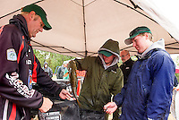 Ray Meyer of Bass Nation weighs in a large mouth bass caught by Josh Holden and Jeremy Bates of Bishop Brady High School during the NHIAA State Bass Tournament on Lake Winnisquam Saturday.  (Karen Bobotas/for the Laconia Daily Sun)
