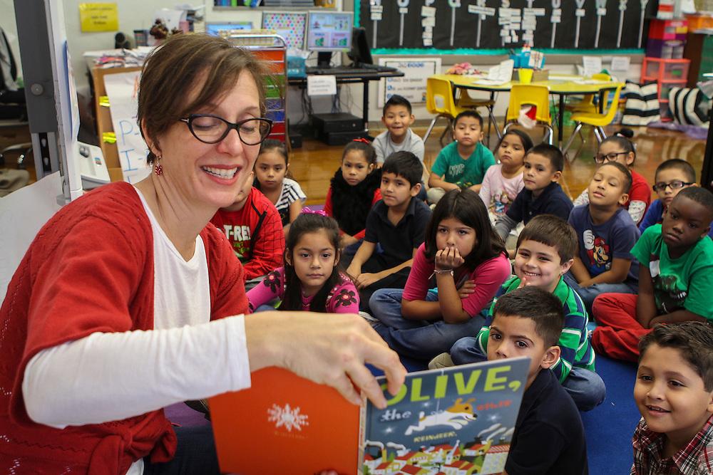 Houston ISD trustee Anna Eastman reads to students at Jefferson Elementary School, December 16, 2015.