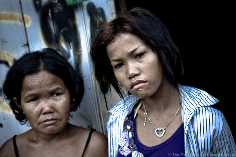 Mother and daughter in a Phnom Penh slum. Investigators later found the mother was pimping her drug-addicted teenage daughter nightly to upwards of 10 Cambodian men.