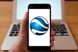 Using iPhone smartphone to display logo of Google Earth satellite imaging service