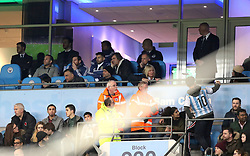 Lionel Messi and Sergio Aguero are seen in the stands during the international friendly match at the Etihad Stadium, Manchester.