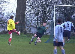 WELDONS NO 9 FIRES IN WELDONS GOAL PAST NOMADS KEEPER NATHAN HEADS 5/2-05