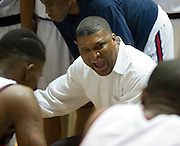 Kimball head coach Royce Johnson has words for his team during a timeout in the Class 4A area-round playoff game against Carrollton Newman Smith Friday, February 22, 2013 at the Alfred J. Loos Field House in Addison, Texas. (Cooper Neill/The Dallas Morning News)
