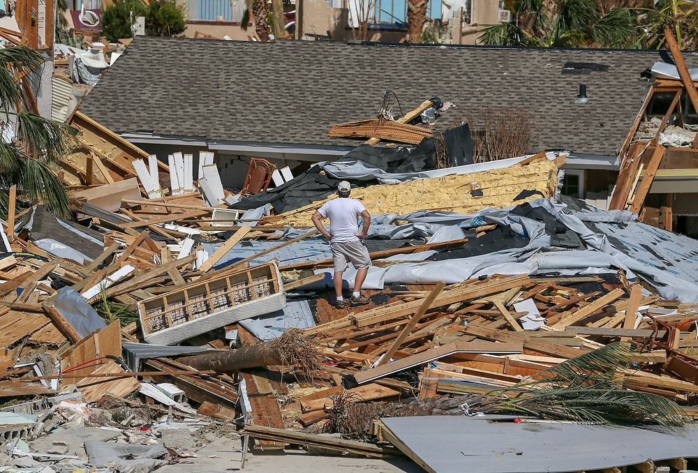 """Jay Faulk, 56, surveys the damage to his home Friday, Oct. 12, 2018 in Mexico Beach. Faulk, 56, is from Macon, Georgia but also has a home along Mexico Beach. """"For a short time we were thinking we would lose both homes"""", said Faulk."""