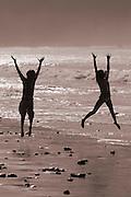 Kids playing in the surf on Sand Dollar Beach, Big Sur Coast, California USA