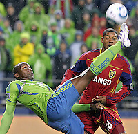 The Seattle Sounders' Jhon Kennedy Hurtado, left, grabs at  Reat Salt Lake's Chris Schuler's uniform as he goes down while kicking the ball during Wednesday's game at CenturyLink Field, in Seattle, November 2, 2011.(Janet Jensen/Staff photographer)