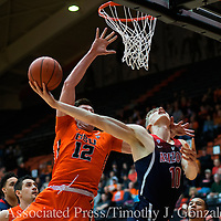 Arizona's Lauri Markkanen (10) is fouled by Oregon State' s Drew Eubanks (12) during the first half of an NCAA college basketball game in Corvallis, Ore., Thursday, Feb. 2, 2017. (AP Photo/Timothy J. Gonzalez)