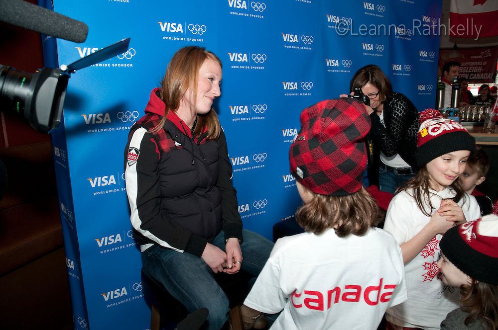 Gold medalist for bobsleigh  Heather Moyse signs autographs after winning the gold with teammate Kaillie Humphries during the 2010 Olympic Winter Games in Whistler, BC, Canada.