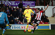 Brentford striker Lasse Vibe with another shot on the Milton Keynes Dons goal during the Sky Bet Championship match between Brentford and Milton Keynes Dons at Griffin Park, London, England on 5 December 2015. Photo by Matthew Redman.