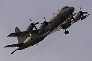 A Lockheed P-3C Orion Maritime reconnaissance aircraft with the Japanese Maritime Self Defence Force flying over Chou Rinkan, Kanagawa, Japan. Tuesday May 23rd 2017