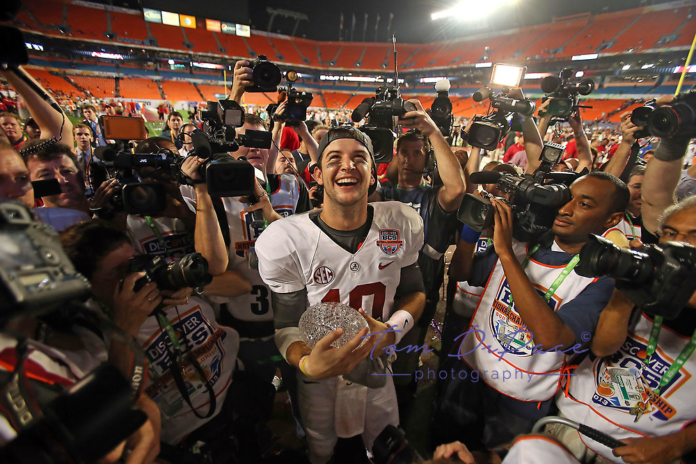 Alabama's AJ McCarron holds The Coaches Trophy after the BCS National Championship college football game against Notre Dame Monday, Jan. 7, 2013, in Miami. Alabama won 42-14<br /> (Photo/Tom DiPace)