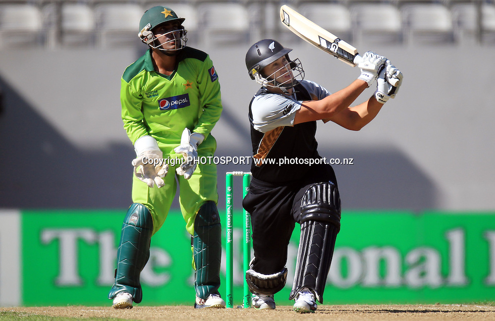 New Zealand captain Ross Taylor hits a 6 as Pakistan wicketkeeper Umar Akmal looks on. wenty20 International Cricket match between The New Zealand Black Caps and Pakistan at Eden Park on Boxing Day, Sunday 26 December 2010. Photo: Andrew Cornaga/photosport.co.nz