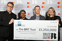 Stuart Worden (Principal of The BRIT School), Rahnee Prescod (BRIT School Student), Geoff Taylor (BPI & BRIT Awards CEO) and Nicola Grant (Vice President, Integrated Marketing & Communications – Mastercard UK, Ireland, Nordics & Baltics) pose with the BRIT Awards 2019 BRITs Trust donation cheque.<br /> <br />  The BRITs Are Coming' Launch Announcement, The Regent Street Cinema, 307 Regent Street, London, UK, Friday 10 January 2020<br /> Photo JM Enternational