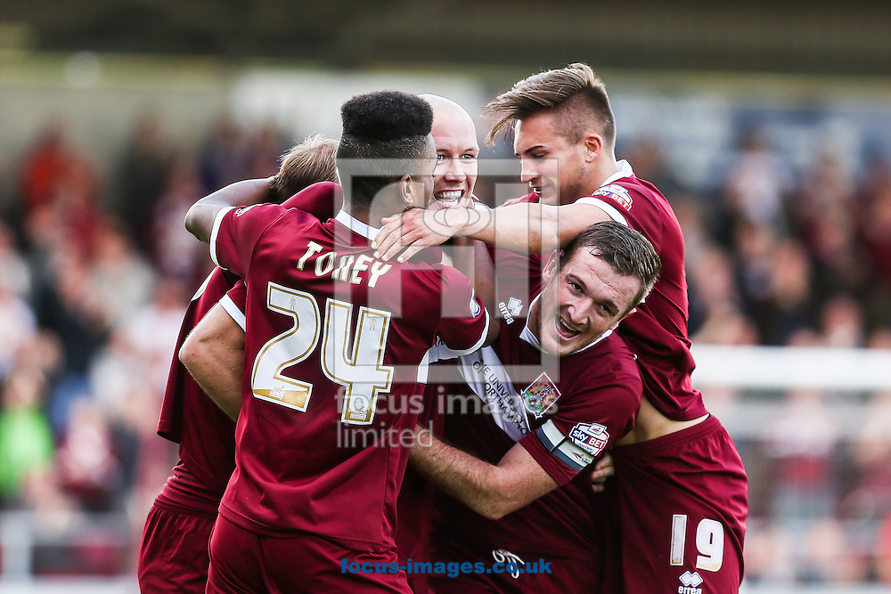 Ryan Cresswell of Northampton Town (centre)  celebrates after scoring during the Sky Bet League 2 match at Sixfields Stadium, Northampton<br /> Picture by Andy Kearns/Focus Images Ltd 0781 864 4264<br /> 11/10/2014