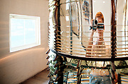 A tourist videofilms through the fresnell lens inside the Key West Lighthouse. Key West on the southern-most tip of Florida is a popular tourist destination, with a very different vibe to it than Miami.