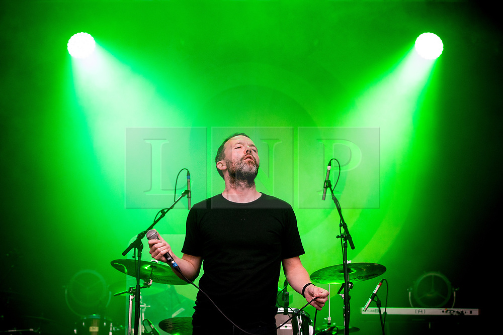"© Licensed to London News Pictures . 07/07/2017 . Manchester , UK . Lead singer AARON STARKIE . "" The Slow Readers Club "" perform live at the Castlefield Bowl as part of Sounds of the City , during the Manchester International Festival . Photo credit : Joel Goodman/LNP"