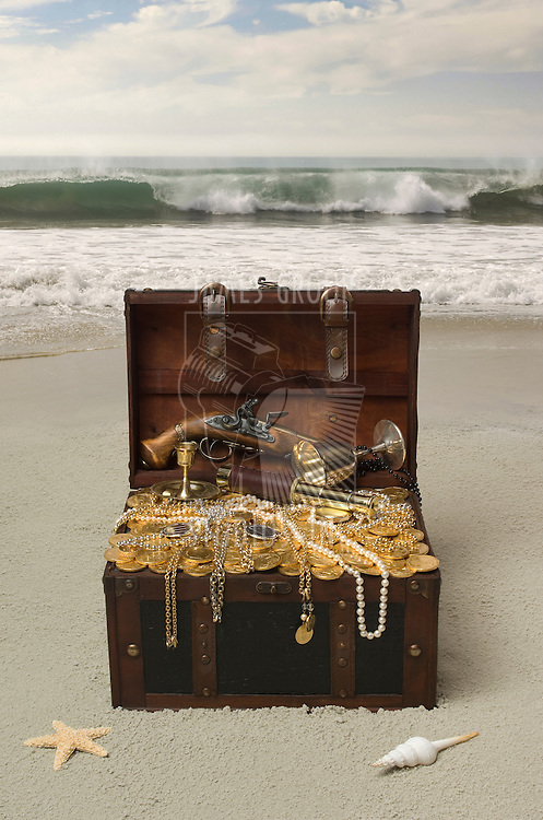 Open treausre chest on a deserted beach