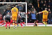 Grimsby Town goalkeeper James McKeown (1) makes a save and Port Vale midfielder Michael Tonge (32) takes a penalty and misses during the EFL Sky Bet League 2 match between Grimsby Town FC and Port Vale at Blundell Park, Grimsby, United Kingdom on 10 March 2018. Picture by Mick Atkins.