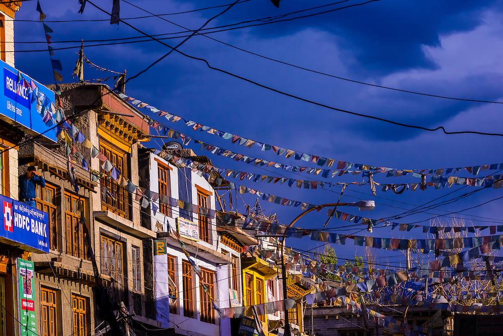 Prayer flags hang from buildings along Main Bazaar Road in old Leh, Ladakh, Jammu and Kashmir State, India.