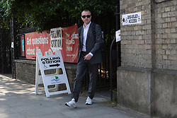 © Licensed to London News Pictures. 11/06/2015. London, UK. A voter leaves a polling station in Shadwell, Tower Hamlets, east London. Tower Hamlets residents go to the polls today to vote for a new Mayor of Tower Hamlets after Lutfur Rahman was removed from office for fraud in corrupt practices by an election court earlier this year. Photo credit : Vickie Flores/LNP