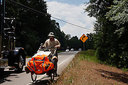"""DACULA, GA – JUNE 6, 2014: Facing oncoming traffic, Karl Bushby travels along the narrow shoulder of Highway 124 several miles east of Atlanta, Georgia. Bushy walks about 20 miles a day, and has admitted that his quest to get permission to travel through Russia is a long shot. """"If I skip Russia and just start walking through China, I've failed.""""<br /> <br /> Karl Bushby is trying to complete the longest walk in history. Unless the Russians stop him. As a 45 year-old Brit, Bushby been traveling around the world on foot since 1998. In the most recent leg of his journey, Bushby is walking to Washington, D.C. to petition the Russian Embassy to lift a visa ban that prohibited him from continuing his hike through Russia."""