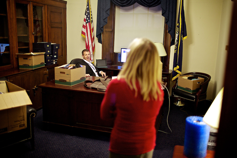 Congressman-elect Markwayne Mullin, from Oklahoma's 2nd District, left, makes decisions about his future office in the Longworth House Office Building in Washington, DC on Nov. 29, 2012.