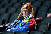 A Wycombe Wanderers fan wearing a cows head furry hat during the EFL Trophy match between Milton Keynes Dons and Wycombe Wanderers at stadium:mk, Milton Keynes, England on 12 November 2019.
