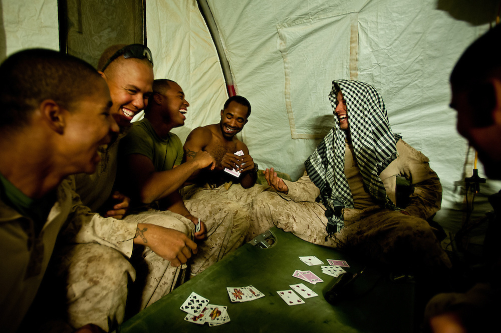 Marines play cards in a tent on Combat Outpost Coutu.