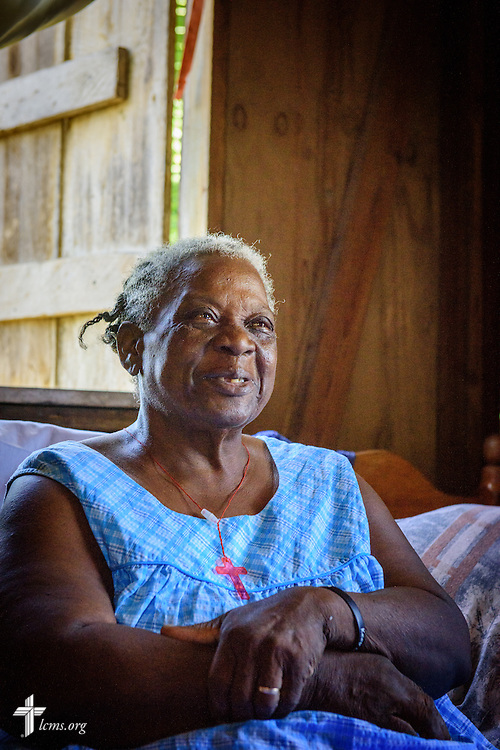 Lovina listens as the Rev. Duane Meissner, career missionary to Belize, reads a devotion during a visit to her home on Tuesday, Sept. 27, 2016, in the village of Seine Bight, Belize. Meissner's objective is to plant the first Lutheran churches in the country. LCMS Communications/Erik M. Lunsford