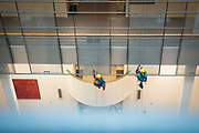 Window cleaners in action in the PHS building in Brussels.