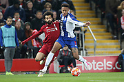 Liverpool forward Mohamed Salah (11) and FC Porto defender Eder Militao (3) during the Champions League Quarter-Final Leg 1 of 2 match between Liverpool and FC Porto at Anfield, Liverpool, England on 9 April 2019.