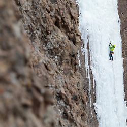 Erik Welborn climbing an unnamed, 3 pitch, WI4 route beside High on Boulder in Cody, Wyoming