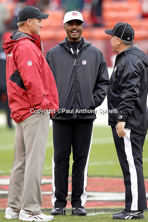 Arizona Cardinals head coach Ken Whisenhunt talks during pregame with NFL referee Mike Carey (94) and another official during the NFL week 17 football game against the San Francisco 49ers on Sunday, January 2, 2011 in San Francisco, California. The 49ers won the game 38-7. (©Paul Anthony Spinelli)