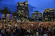 Thousands of people attend a vigil in the wake of the Pulse Nightclub shooting, held in downtown Orlando at Dr. Phillips Center for the Performing Arts Monday evening. A gunmen opened fire in a gay nightclub in Orlando, Fla. early Sunday morning killing 49 people and wounding 53 more. It's being called the worst mass shooting in U.S. history.