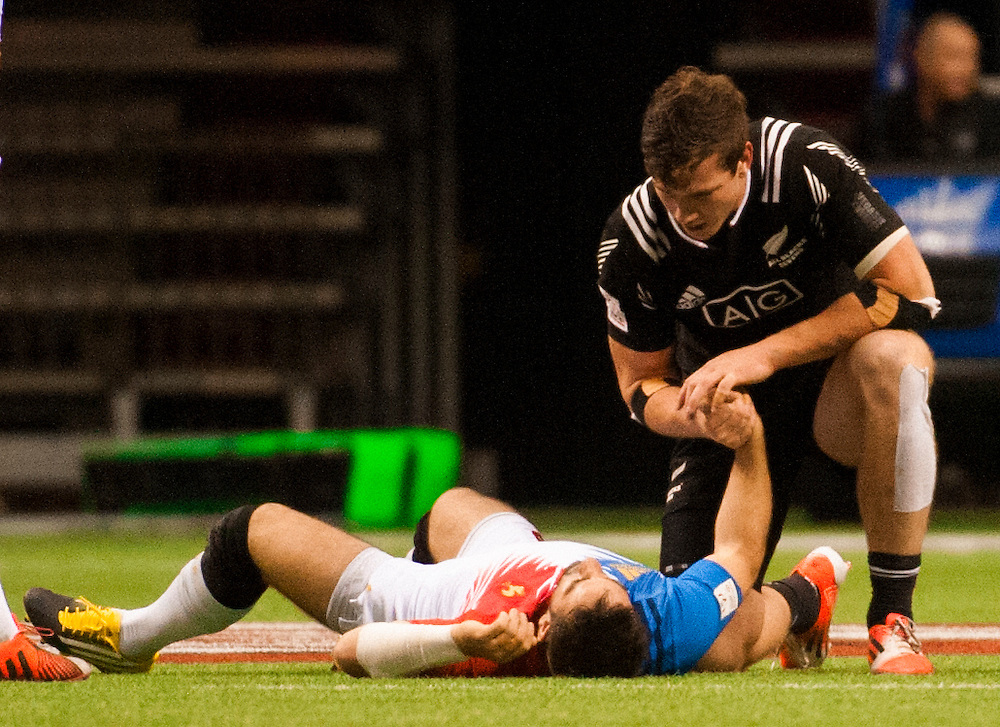 Sam Dickson of New Zealand comforts Julien Candelon of France after a dangerous tackle for which Dickson was booked during the pool stages of the 2016 Canada Sevens leg of the HSBC Sevens World Series Series at BC Place in  Vancouver, British Columbia. Saturday March 12, 2016.<br /> <br /> Jack Megaw<br /> <br /> www.jackmegaw.com<br /> <br /> 610.764.3094<br /> jack@jackmegaw.com