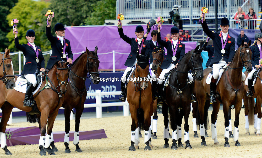 31.07.2012. Greenwich Park, London England. GB Eventing Team win silver medal L-R Zara Phillips, Tina Cook, Mary King, Nicola Wilson, William Fox-Pitt