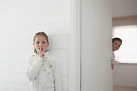 Siblings Playing Hide-and-Seek