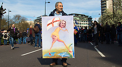 London, March 25th 2017. PICTURED: Political satire artist Kaya Mar displays his latest painting as protesters in the Unite for Europe march against Brexit take to the streets of London just days after the Westminster terror attack in a show of defiance against extremism and Prime Minister Theresa May's 'hard Brexit'.