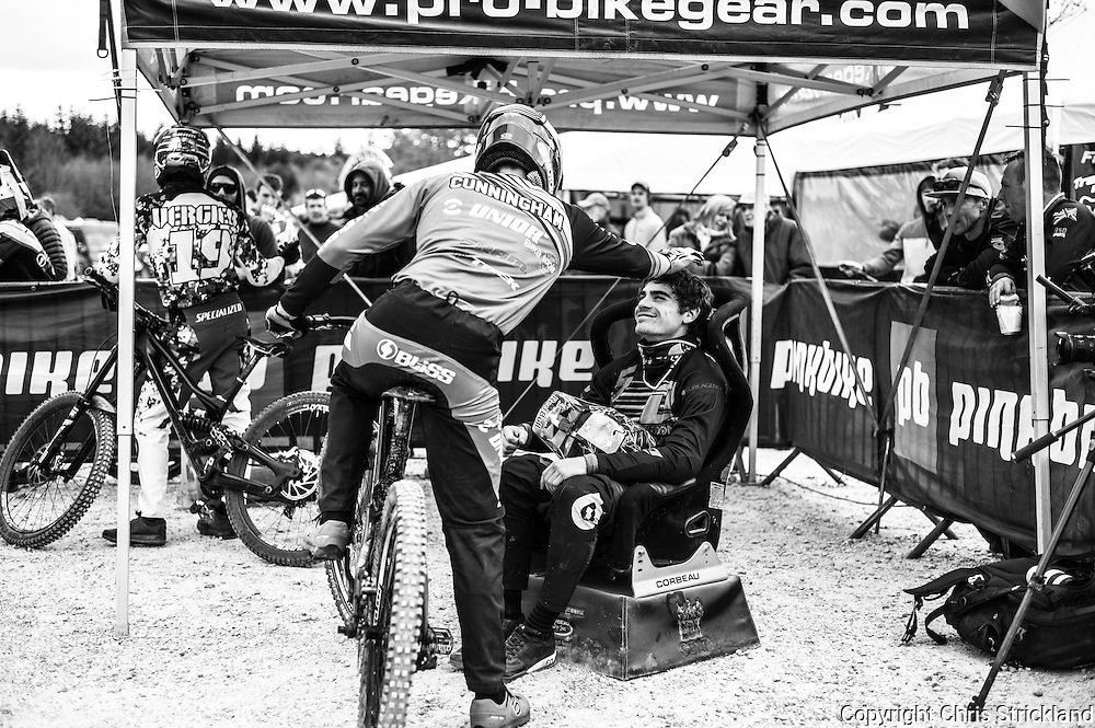 Nevis Range, Fort William, Scottish Highlands, UK. 15th May 2016. Ruaridh Cunningham congratulates Loic Bruni while he's sat in the hot seat at the British Downhill Series on Nevis Range in the Scottish Highlands.