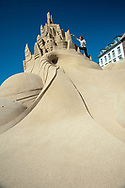 Morton Nauntofte is pictured adding a few finishing touches to one of the sand sculptures at the 2013 Copenhagen Sand Festival An amazing feat of the imagination, sculpting from our abundant natural resource, sand, are these amazing shapes that resemble real-world objects and artefacts.