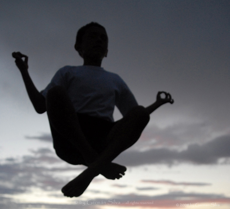 Sunset levitation -- &quot;pure bliss.&quot;  (Diego in a meditative pose high in the air, after jumping in the backyard's trampoline.)<br />