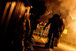 05.12.2016, Kaprun, AUT, Pinzgauer Krampustage im Bild Mitglieder verschiedener Krampusgruppen beim Krampusumzug // A man dressed as a devil performs during a Krampus show. Krampus a mythical creature that, according to legend, accompanies Saint Nicholas during the festive season. Instead of giving gifts to good children, he punishes the bad ones, Kaprun, Austria on 2016/12/05. EXPA Pictures © 2016, PhotoCredit: EXPA/ JFK