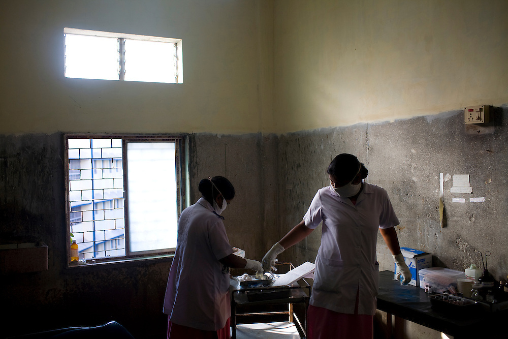 Nurses prepare to distribute the daily TB medicines at the Group of TB Hospitals in Mumbai.