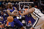 Oct 16, 2014; Phoenix, AZ, USA; Phoenix Suns forward Anthony Tolliver (40) handles the ball against the San Antonio Spurs forward Boris Diaw (33) in the first half at US Airways Center. Mandatory Credit: Jennifer Stewart-USA TODAY Sports
