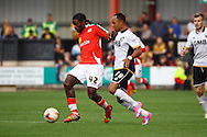 Crewe Alexandra&rsquo;s Anthony Grant (l) looks to get away from Port Vale&rsquo;s Byron Moore. Skybet football league one match, Crewe Alexandra v Port Vale at the Alexandra Stadium in Crewe on Saturday 13th Sept 2014.<br /> pic by Chris Stading, Andrew Orchard sports photography.