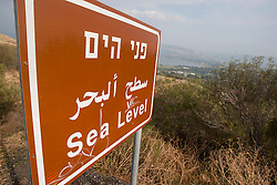 Sing showing Sea Level on a visit to the Sea of Galilee. Sunday 2nd Jan, 2011. Day three visit to a kibbutz. Train & Travel is a unique ten day program designed for IKMF's instructors, students & guests, interested in combining Krav Maga training with a tour of the holy land. .©2011 Michael Schofield. All Rights Reserved.