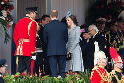 © London News Pictures. 21/10/2014.   Catherine Duchess of Cambridge and Prince William accompany HRH Queen Elizabeth II as she Greets the President of the Republic of Singapore,  Tony Tan Keng Yam and his wife Mary Chee Bee Kiang on Horseguards Parade in London as part of a Ceremonial welcome for the Singapore state visit.  Photo credit : Ben Cawthra/LNP